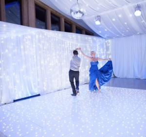 white fairy light curtain with LED dance floor